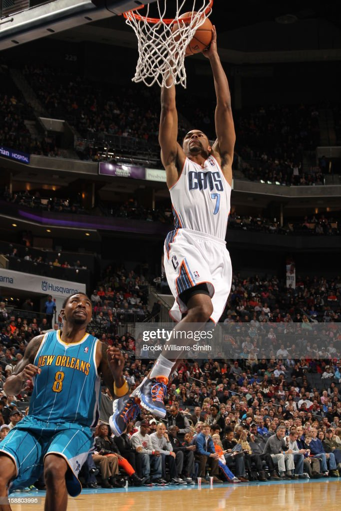 <a gi-track='captionPersonalityLinkClicked' href=/galleries/search?phrase=Ramon+Sessions&family=editorial&specificpeople=805440 ng-click='$event.stopPropagation()'>Ramon Sessions</a> #7 of the Charlotte Bobcats dunks against Roger Mason #8 of the New Orleans Hornets at the Time Warner Cable Arena on December 29, 2012 in Charlotte, North Carolina.