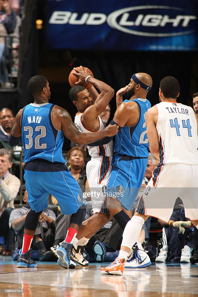Ramon Sessions #7 of the Charlotte Bobcats fights for the ball against Vince Carter #25 of the Dallas Mavericks at the Time Warner Cable Arena on November 10, 2012 in Charlotte, North Carolina.