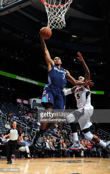 Ramon Sessions of the Charlotte Bobcats goes in for the easy layup against the Atlanta Hawks at Philips Arena on November 28 2012 in Atlanta Georgia...