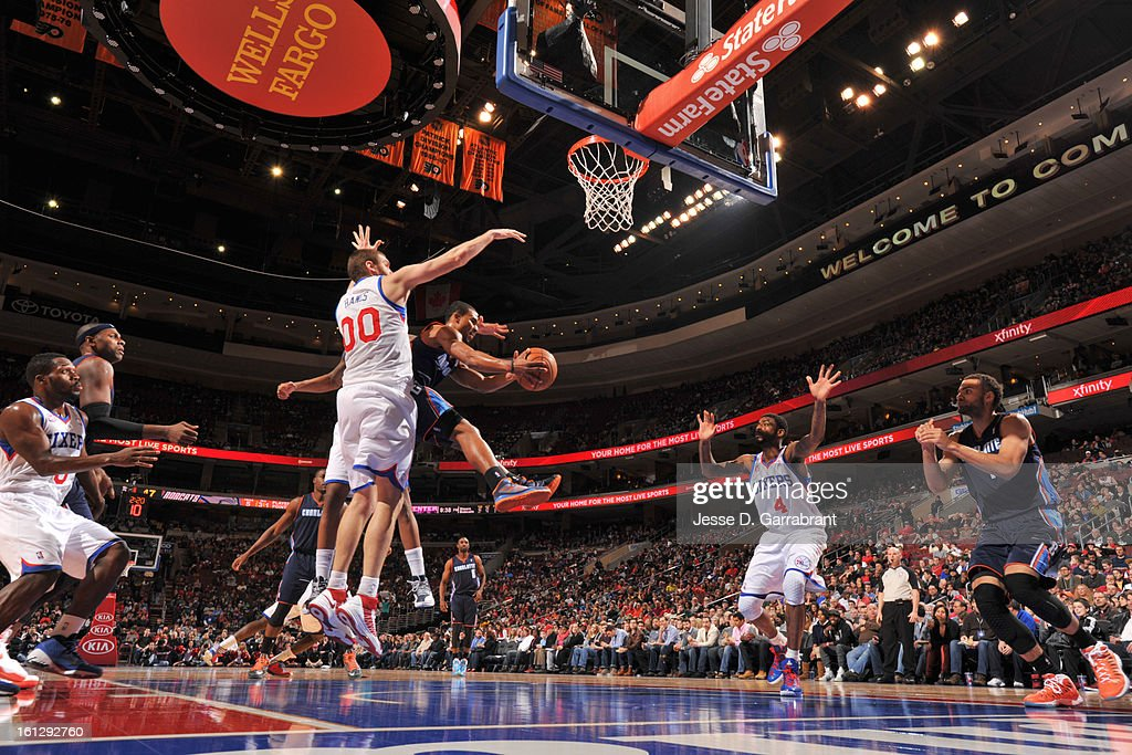 Ramon Sessions #7 of the Charlotte Bobcats goes to the basket against <a gi-track='captionPersonalityLinkClicked' href=/galleries/search?phrase=Spencer+Hawes&family=editorial&specificpeople=3848319 ng-click='$event.stopPropagation()'>Spencer Hawes</a> #00 of the Philadelphia 76ers during the game at the Wells Fargo Center on February 9, 2013 in Philadelphia, Pennsylvania.