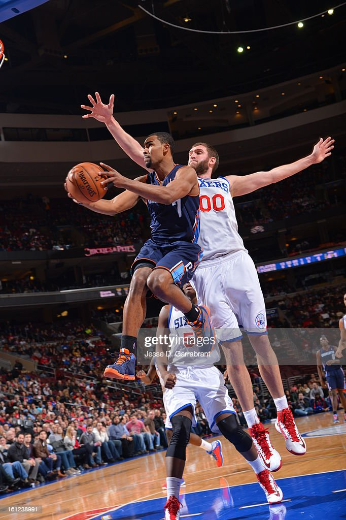 Ramon Sessions #7 of the Charlotte Bobcats goes up for a basket against Spencer Hawes #00 of the Philadelphia 76ers during the game at the Wells Fargo Center on February 9, 2013 in Philadelphia, Pennsylvania.