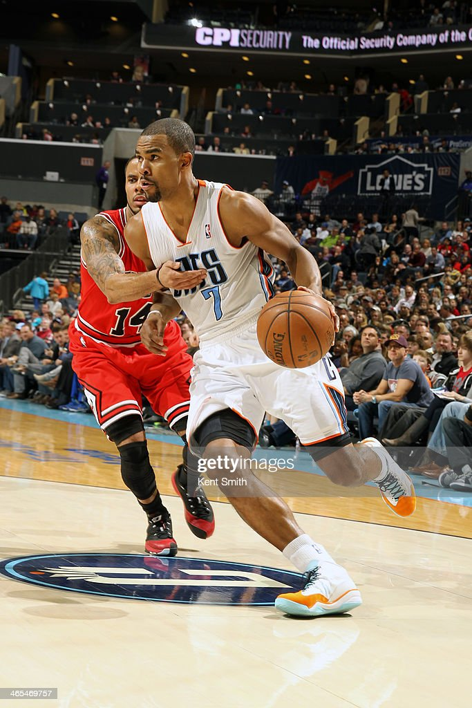 <a gi-track='captionPersonalityLinkClicked' href=/galleries/search?phrase=Ramon+Sessions&family=editorial&specificpeople=805440 ng-click='$event.stopPropagation()'>Ramon Sessions</a> #7 of the Charlotte Bobcats handles the ball against the Chicago Bulls at the Time Warner Cable Arena on January 25, 2014 in Charlotte, North Carolina.