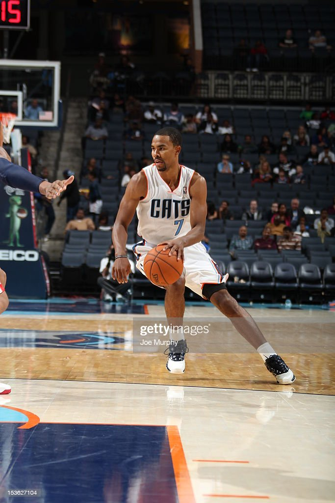 Ramon Sessions #7 of the Charlotte Bobcats protects the ball during the game between the Charlotte Bobcats and the Washington Wizards at the Time Warner Cable Arena on October 7, 2012 in Charlotte, North Carolina.