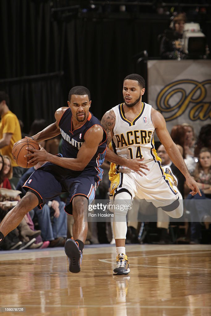 Ramon Sessions #7 of the Charlotte Bobcats protects the ball from D.J. Augustin #14 of the Indiana Pacers during the game between the Indiana Pacers and the Charlotte Bobcats on January 12, 2013 at Bankers Life Fieldhouse in Indianapolis, Indiana.