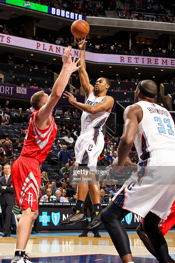 Ramon Sessions #7 of the Charlotte Bobcats shoots against Cole Aldrich #31 of the Houston Rockets at the Time Warner Cable Arena on January 21, 2013 in Charlotte, North Carolina.