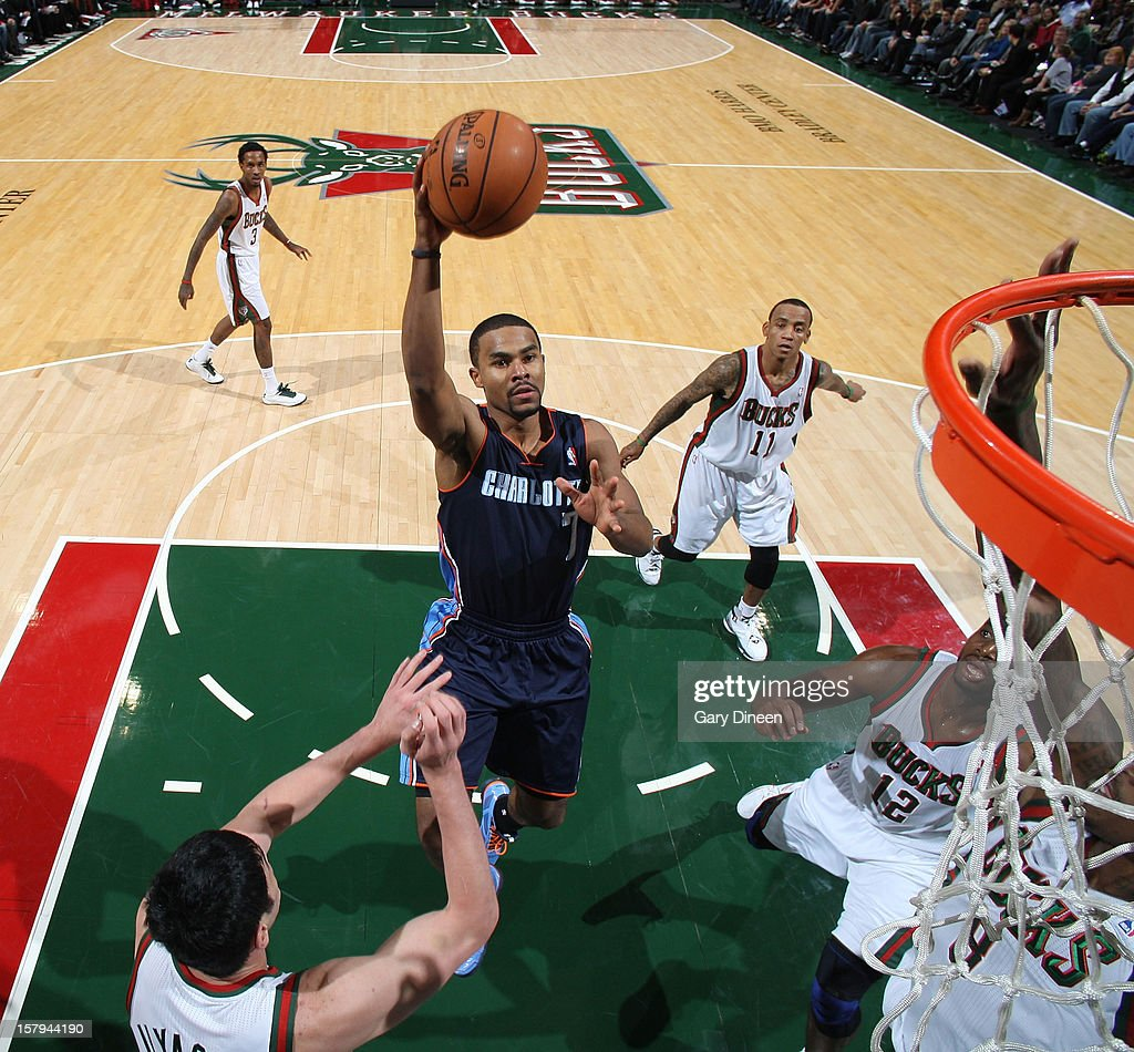 <a gi-track='captionPersonalityLinkClicked' href=/galleries/search?phrase=Ramon+Sessions&family=editorial&specificpeople=805440 ng-click='$event.stopPropagation()'>Ramon Sessions</a> #7 of the Charlotte Bobcats shoots against <a gi-track='captionPersonalityLinkClicked' href=/galleries/search?phrase=Ersan+Ilyasova&family=editorial&specificpeople=557070 ng-click='$event.stopPropagation()'>Ersan Ilyasova</a> #7 of the Milwaukee Bucks during the game on December 7, 2012 at the BMO Harris Bradley Center in Milwaukee, Wisconsin.