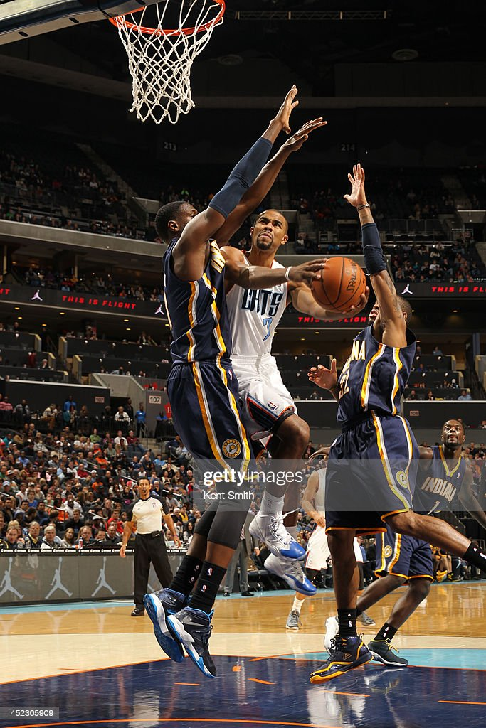 <a gi-track='captionPersonalityLinkClicked' href=/galleries/search?phrase=Ramon+Sessions&family=editorial&specificpeople=805440 ng-click='$event.stopPropagation()'>Ramon Sessions</a> #7 of the Charlotte Bobcats shoots against <a gi-track='captionPersonalityLinkClicked' href=/galleries/search?phrase=Ian+Mahinmi&family=editorial&specificpeople=740196 ng-click='$event.stopPropagation()'>Ian Mahinmi</a> #28 of the Indiana Pacers during the game at the Time Warner Cable Arena on November 27, 2013 in Charlotte, North Carolina.