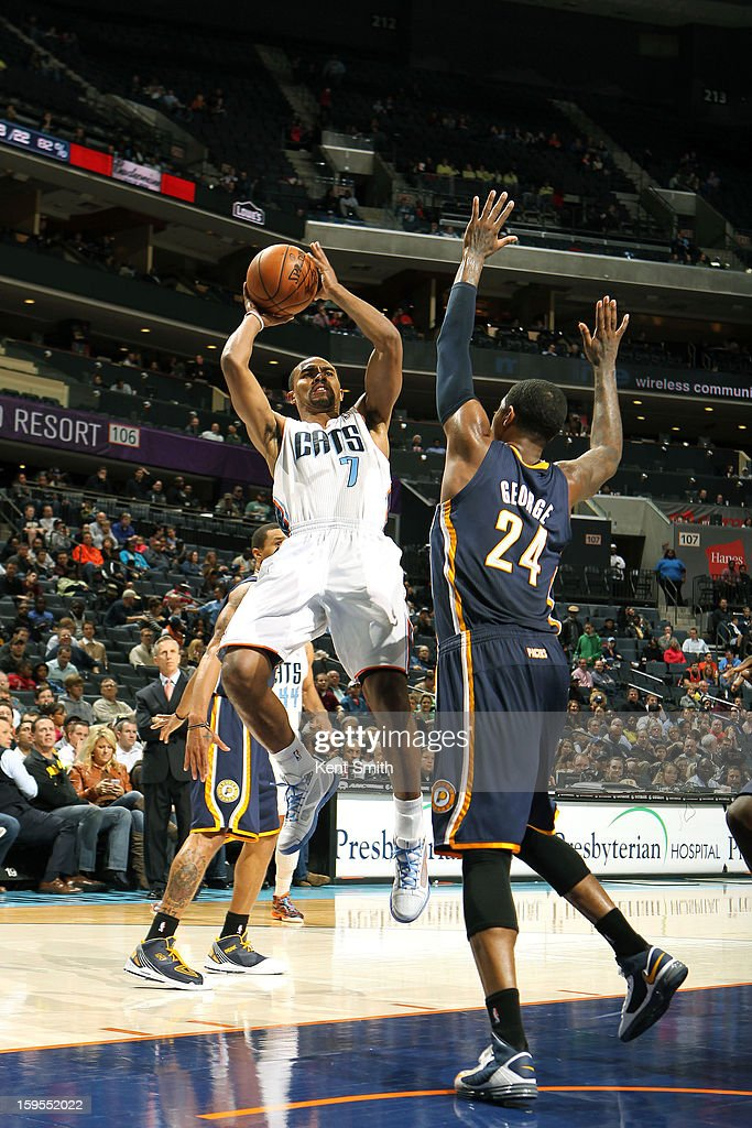 Ramon Sessions #7 of the Charlotte Bobcats shoots against Paul George #24 of the Indiana Pacers at the Time Warner Cable Arena on January 15, 2013 in Charlotte, North Carolina.