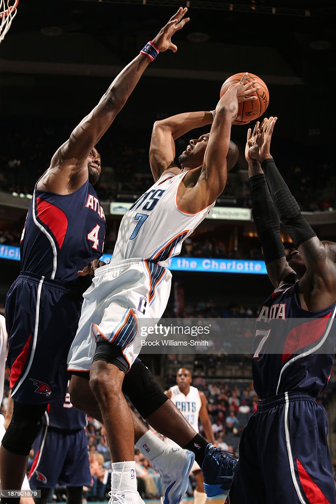 <a gi-track='captionPersonalityLinkClicked' href=/galleries/search?phrase=Ramon+Sessions&family=editorial&specificpeople=805440 ng-click='$event.stopPropagation()'>Ramon Sessions</a> #7 of the Charlotte Bobcats shoots against <a gi-track='captionPersonalityLinkClicked' href=/galleries/search?phrase=Paul+Millsap&family=editorial&specificpeople=880017 ng-click='$event.stopPropagation()'>Paul Millsap</a> #4 of the Atlanta Hawks during the game at the Time Warner Cable Arena on November 11, 2013 in Charlotte, North Carolina.
