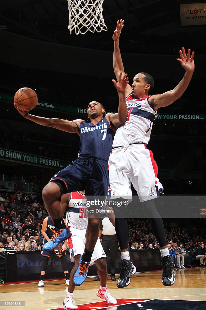 Ramon Sessions #7 of the Charlotte Bobcats shoots against Shaun Livingston #14 of the Washington Wizards during the game at the Verizon Center on November 24, 2012 in Washington, DC.