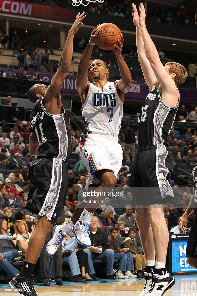 Ramon Sessions #7 of the Charlotte Bobcats shoots against the San Antonio Spurs at the Time Warner Cable Arena on December 8, 2012 in Charlotte, North Carolina.