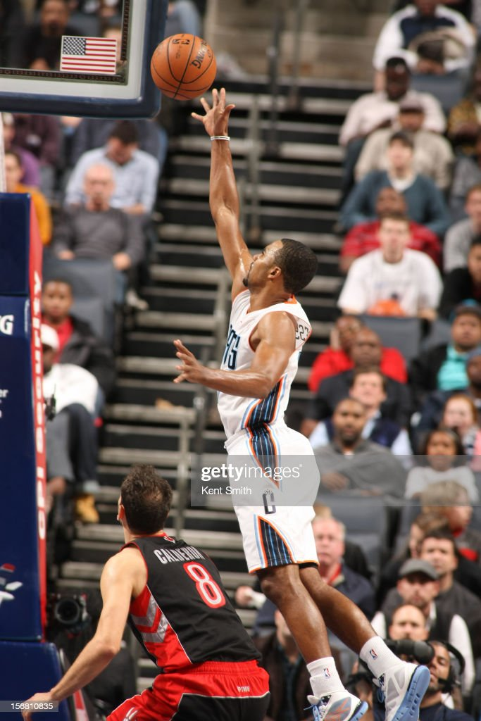 <a gi-track='captionPersonalityLinkClicked' href=/galleries/search?phrase=Ramon+Sessions&family=editorial&specificpeople=805440 ng-click='$event.stopPropagation()'>Ramon Sessions</a> #7 of the Charlotte Bobcats shoots against the Toronto Raptors at the Time Warner Cable Arena on November 21, 2012 in Charlotte, North Carolina.