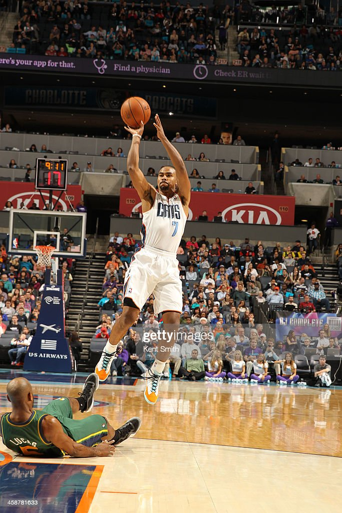<a gi-track='captionPersonalityLinkClicked' href=/galleries/search?phrase=Ramon+Sessions&family=editorial&specificpeople=805440 ng-click='$event.stopPropagation()'>Ramon Sessions</a> #7 of the Charlotte Bobcats shoots against the Utah Jazz during the game at the Time Warner Cable Arena on December 21, 2013 in Charlotte, North Carolina.