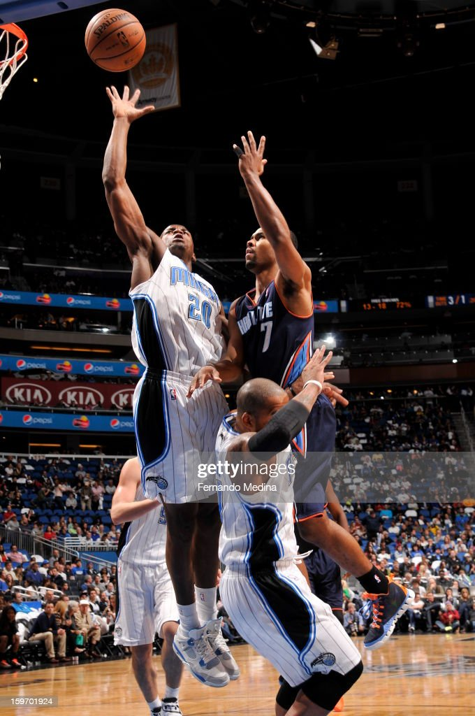 Ramon Sessions #7 of the Charlotte Bobcats shoots over DeQuan Jones #20 of the Orlando Magic on January 18, 2013 at Amway Center in Orlando, Florida.