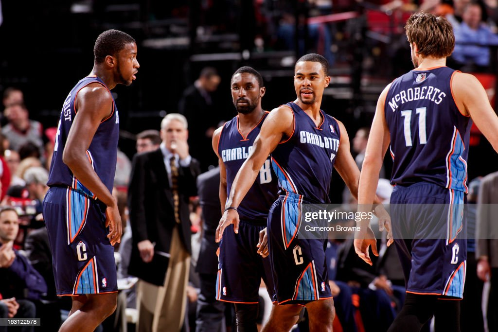 Ramon Sessions #7 of the Charlotte Bobcats speaks to teammates Michael Kidd-Gilchrist #14, Ben Gordon #8 and Josh McRoberts #11 during a game against the Portland Trail Blazers on March 4, 2013 at the Rose Garden Arena in Portland, Oregon.