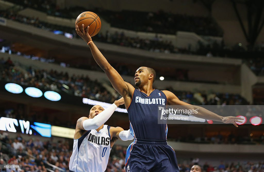 <a gi-track='captionPersonalityLinkClicked' href=/galleries/search?phrase=Ramon+Sessions&family=editorial&specificpeople=805440 ng-click='$event.stopPropagation()'>Ramon Sessions</a> #7 of the Charlotte Bobcats takes a shot against <a gi-track='captionPersonalityLinkClicked' href=/galleries/search?phrase=Shawn+Marion&family=editorial&specificpeople=201566 ng-click='$event.stopPropagation()'>Shawn Marion</a> #0 of the Dallas Mavericks at American Airlines Center on December 3, 2013 in Dallas, Texas.