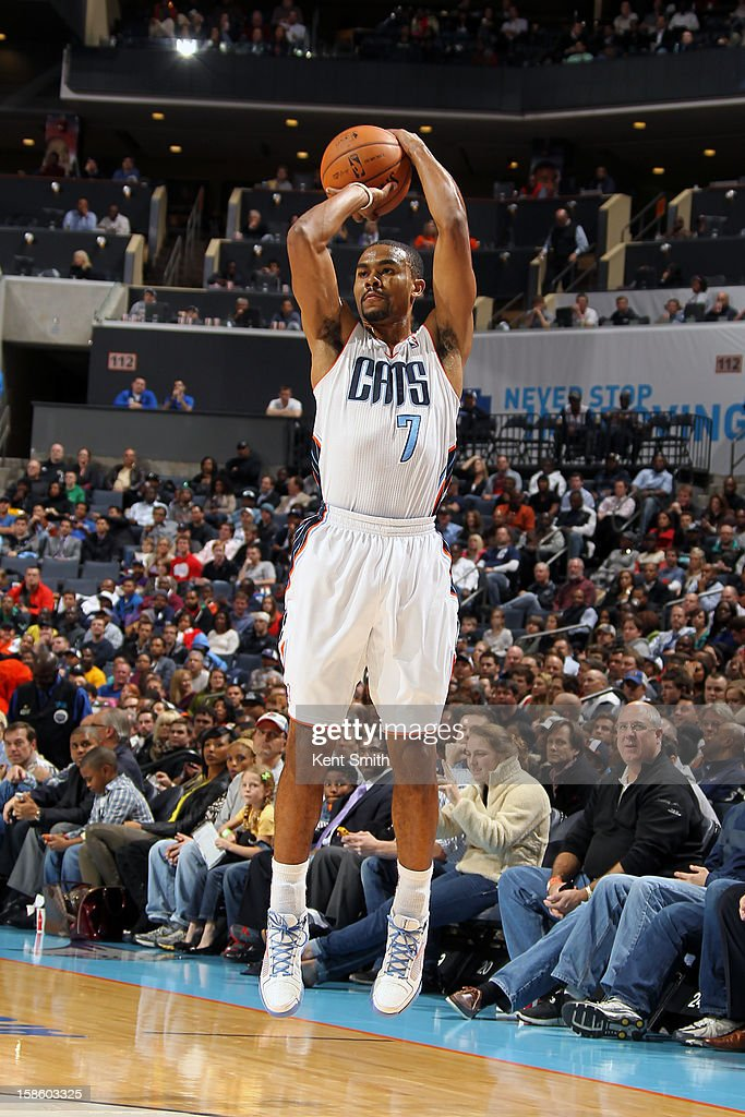<a gi-track='captionPersonalityLinkClicked' href=/galleries/search?phrase=Ramon+Sessions&family=editorial&specificpeople=805440 ng-click='$event.stopPropagation()'>Ramon Sessions</a> #7 of the Charlotte Bobcats takes a shot against the Los Angeles Clippers at the Time Warner Cable Arena on December 12, 2012 in Charlotte, North Carolina.