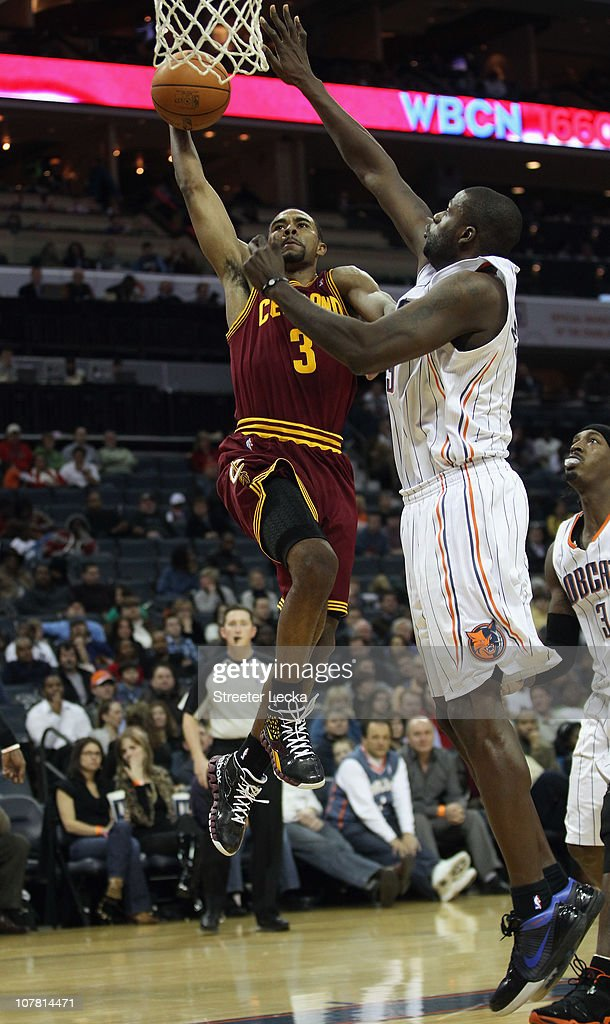 <a gi-track='captionPersonalityLinkClicked' href=/galleries/search?phrase=Ramon+Sessions&family=editorial&specificpeople=805440 ng-click='$event.stopPropagation()'>Ramon Sessions</a> #3 of the Cleveland Cavaliers dunks the ball on <a gi-track='captionPersonalityLinkClicked' href=/galleries/search?phrase=Nazr+Mohammed&family=editorial&specificpeople=201690 ng-click='$event.stopPropagation()'>Nazr Mohammed</a> #13 of the Charlotte Bobcats during their game at Time Warner Cable Arena on December 29, 2010 in Charlotte, North Carolina.