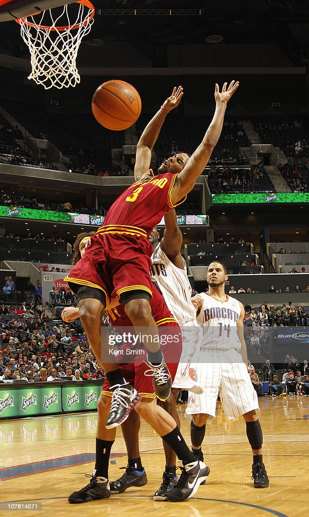 <a gi-track='captionPersonalityLinkClicked' href=/galleries/search?phrase=Ramon+Sessions&family=editorial&specificpeople=805440 ng-click='$event.stopPropagation()'>Ramon Sessions</a> #3 of the Cleveland Cavaliers is fouled by the Charlotte Bobcats on December 29, 2010 at Time Warner Cable Arena in Charlotte, North Carolina.