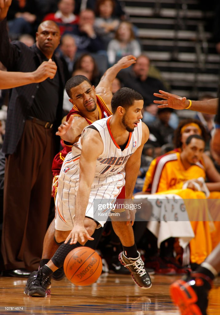 <a gi-track='captionPersonalityLinkClicked' href=/galleries/search?phrase=Ramon+Sessions&family=editorial&specificpeople=805440 ng-click='$event.stopPropagation()'>Ramon Sessions</a> #3 of the Cleveland Cavaliers reaches to steal the ball from <a gi-track='captionPersonalityLinkClicked' href=/galleries/search?phrase=D.J.+Augustin&family=editorial&specificpeople=3847521 ng-click='$event.stopPropagation()'>D.J. Augustin</a> #14 of the Charlotte Bobcats on December 29, 2010 at Time Warner Cable Arena in Charlotte, North Carolina.