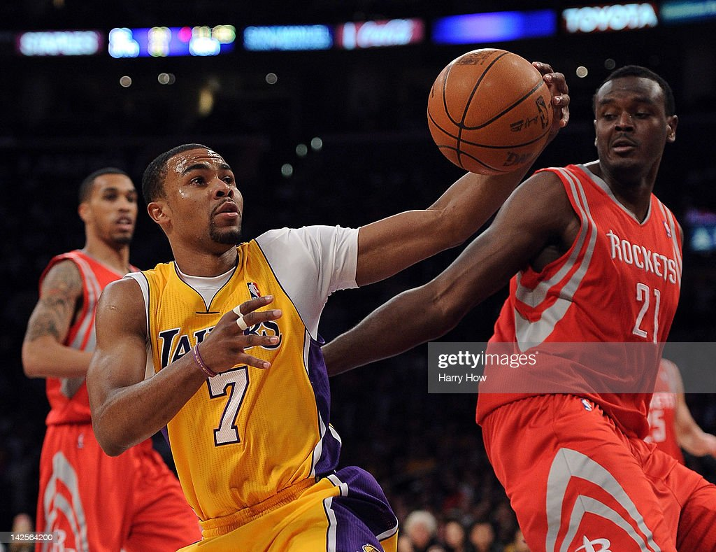 <a gi-track='captionPersonalityLinkClicked' href=/galleries/search?phrase=Ramon+Sessions&family=editorial&specificpeople=805440 ng-click='$event.stopPropagation()'>Ramon Sessions</a> #7 of the Los Angeles Lakers fakes a pass in front of <a gi-track='captionPersonalityLinkClicked' href=/galleries/search?phrase=Samuel+Dalembert&family=editorial&specificpeople=202026 ng-click='$event.stopPropagation()'>Samuel Dalembert</a> #21 of the Houston Rockets at Staples Center on April 6, 2012 in Los Angeles, California.