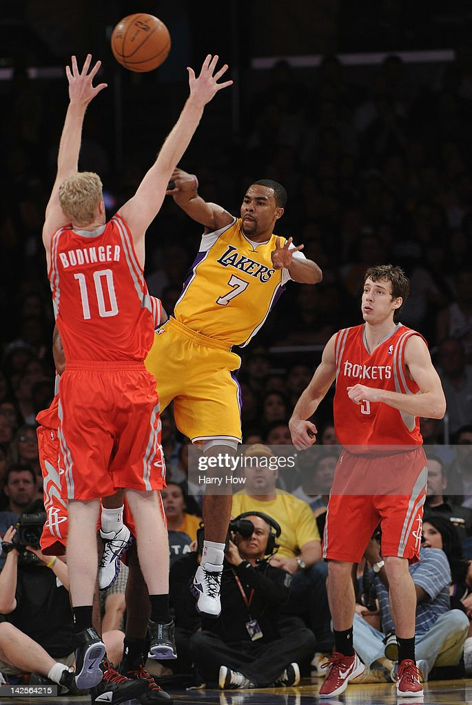 <a gi-track='captionPersonalityLinkClicked' href=/galleries/search?phrase=Ramon+Sessions&family=editorial&specificpeople=805440 ng-click='$event.stopPropagation()'>Ramon Sessions</a> #7 of the Los Angeles Lakers makes a pass aorund <a gi-track='captionPersonalityLinkClicked' href=/galleries/search?phrase=Chase+Budinger&family=editorial&specificpeople=3847600 ng-click='$event.stopPropagation()'>Chase Budinger</a> #10 and <a gi-track='captionPersonalityLinkClicked' href=/galleries/search?phrase=Goran+Dragic&family=editorial&specificpeople=4452965 ng-click='$event.stopPropagation()'>Goran Dragic</a> #3 of the Houston Rockets at Staples Center on April 6, 2012 in Los Angeles, California.
