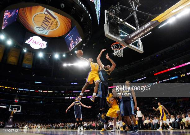 Ramon Sessions of the Los Angeles Lakers shoots the ball over JaVale McGee of the Denver Nuggets in the first half in Game Five of the Western...