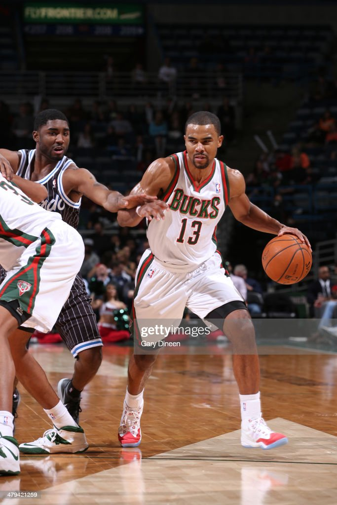 Ramon Sessions #13 of the Milwaukee Bucks dribbles the ball against the Orlando Magic on March 10, 2014 at the BMO Harris Bradley Center in Milwaukee, Wisconsin.