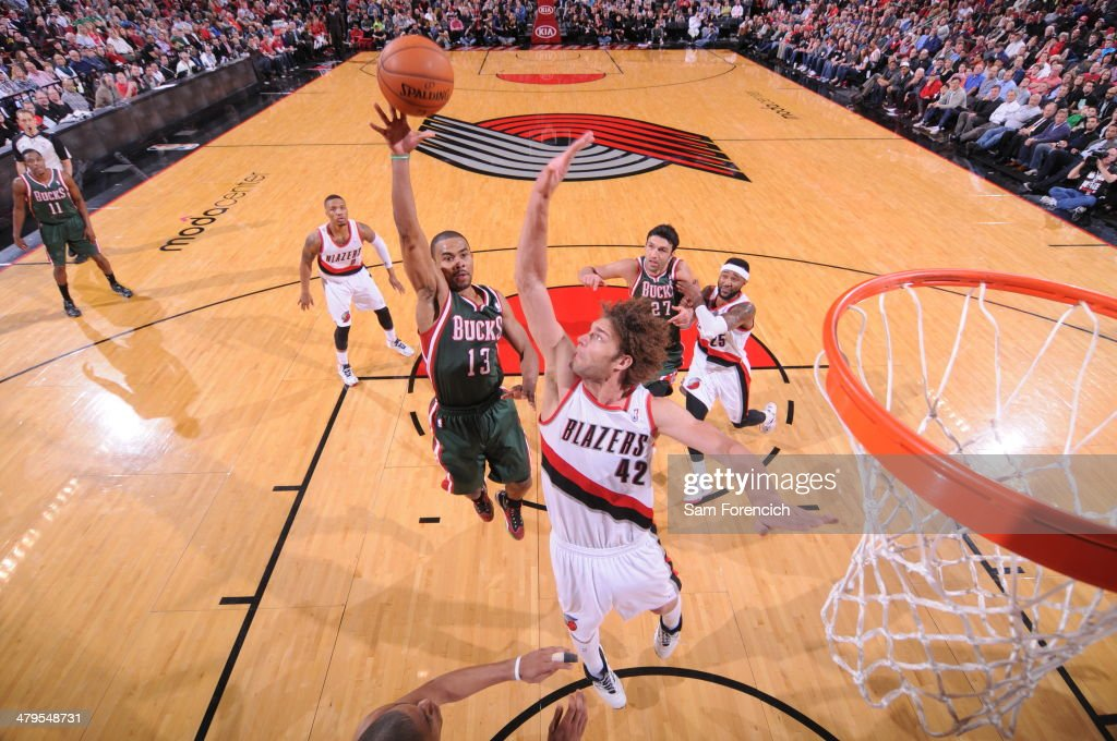 <a gi-track='captionPersonalityLinkClicked' href=/galleries/search?phrase=Ramon+Sessions&family=editorial&specificpeople=805440 ng-click='$event.stopPropagation()'>Ramon Sessions</a> #13 of the Milwaukee Bucks drives to the basket against the Portland Trail Blazers on March 18, 2014 at the Moda Center Arena in Portland, Oregon.