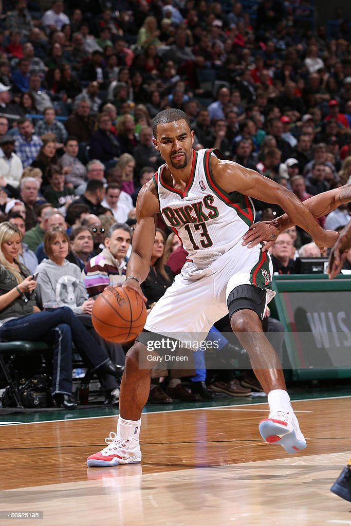 Ramon Sessions #13 of the Milwaukee Bucks drives to the basket against the Indiana Pacers on February 22, 2014 at the BMO Harris Bradley Center in Milwaukee, Wisconsin.