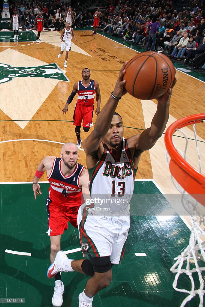 Ramon Sessions #13 of the Milwaukee Bucks dunks against the Washington Wizards on March 8, 2014 at the BMO Harris Bradley Center in Milwaukee, Wisconsin.