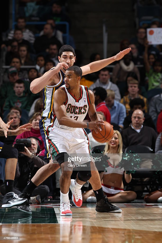 <a gi-track='captionPersonalityLinkClicked' href=/galleries/search?phrase=Ramon+Sessions&family=editorial&specificpeople=805440 ng-click='$event.stopPropagation()'>Ramon Sessions</a> #13 of the Milwaukee Bucks handles the ball against the Utah Jazz on March 3, 2014 at the BMO Harris Bradley Center in Milwaukee, Wisconsin.