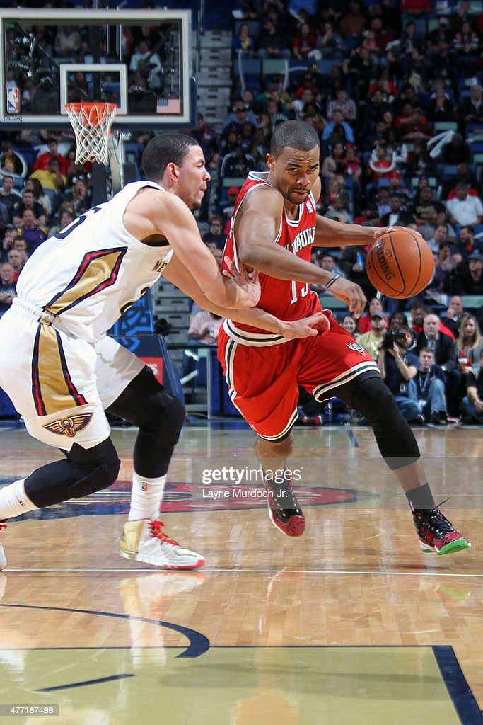 <a gi-track='captionPersonalityLinkClicked' href=/galleries/search?phrase=Ramon+Sessions&family=editorial&specificpeople=805440 ng-click='$event.stopPropagation()'>Ramon Sessions</a> #13 of the Milwaukee Bucks handles the ball against the New Orleans Pelicans on March 7, 2014 at the Smoothie King Center in New Orleans, Louisiana.