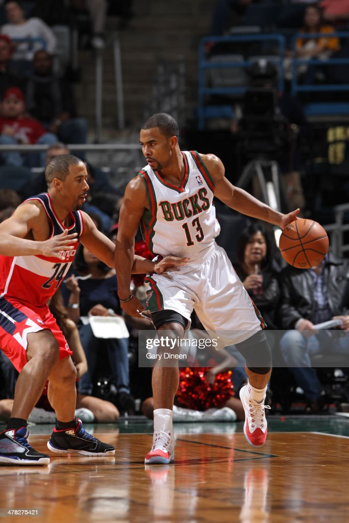 <a gi-track='captionPersonalityLinkClicked' href=/galleries/search?phrase=Ramon+Sessions&family=editorial&specificpeople=805440 ng-click='$event.stopPropagation()'>Ramon Sessions</a> #13 of the Milwaukee Bucks handles the ball against the Washington Wizards on March 8, 2014 at the BMO Harris Bradley Center in Milwaukee, Wisconsin.