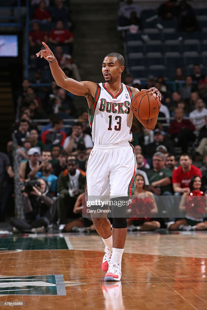 <a gi-track='captionPersonalityLinkClicked' href=/galleries/search?phrase=Ramon+Sessions&family=editorial&specificpeople=805440 ng-click='$event.stopPropagation()'>Ramon Sessions</a> #13 of the Milwaukee Bucks handles the ball against the Sacramento Kings on March 5, 2014 at the BMO Harris Bradley Center in Milwaukee, Wisconsin.