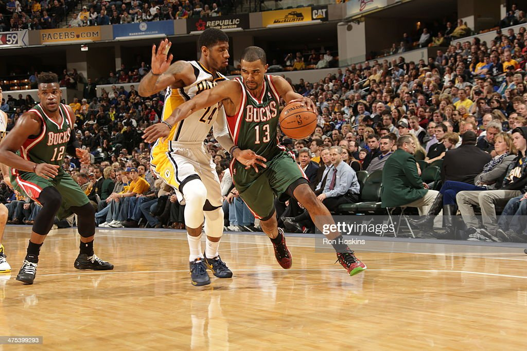 <a gi-track='captionPersonalityLinkClicked' href=/galleries/search?phrase=Ramon+Sessions&family=editorial&specificpeople=805440 ng-click='$event.stopPropagation()'>Ramon Sessions</a> #13 of the Milwaukee Bucks handles the ball during a game against the Indiana Pacers at Bankers Life Fieldhouse on February 25, 2014 in Indianapolis, Indiana.