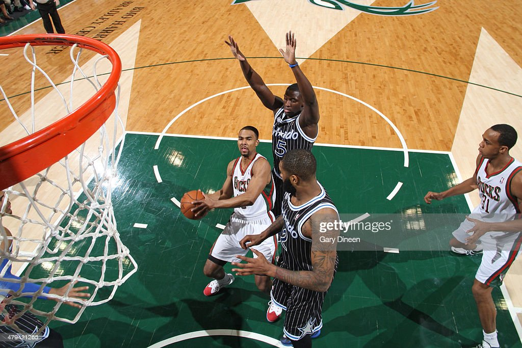 <a gi-track='captionPersonalityLinkClicked' href=/galleries/search?phrase=Ramon+Sessions&family=editorial&specificpeople=805440 ng-click='$event.stopPropagation()'>Ramon Sessions</a> #13 of the Milwaukee Bucks looks to shoot the ball against the Orlando Magic on March 10, 2014 at the BMO Harris Bradley Center in Milwaukee, Wisconsin.