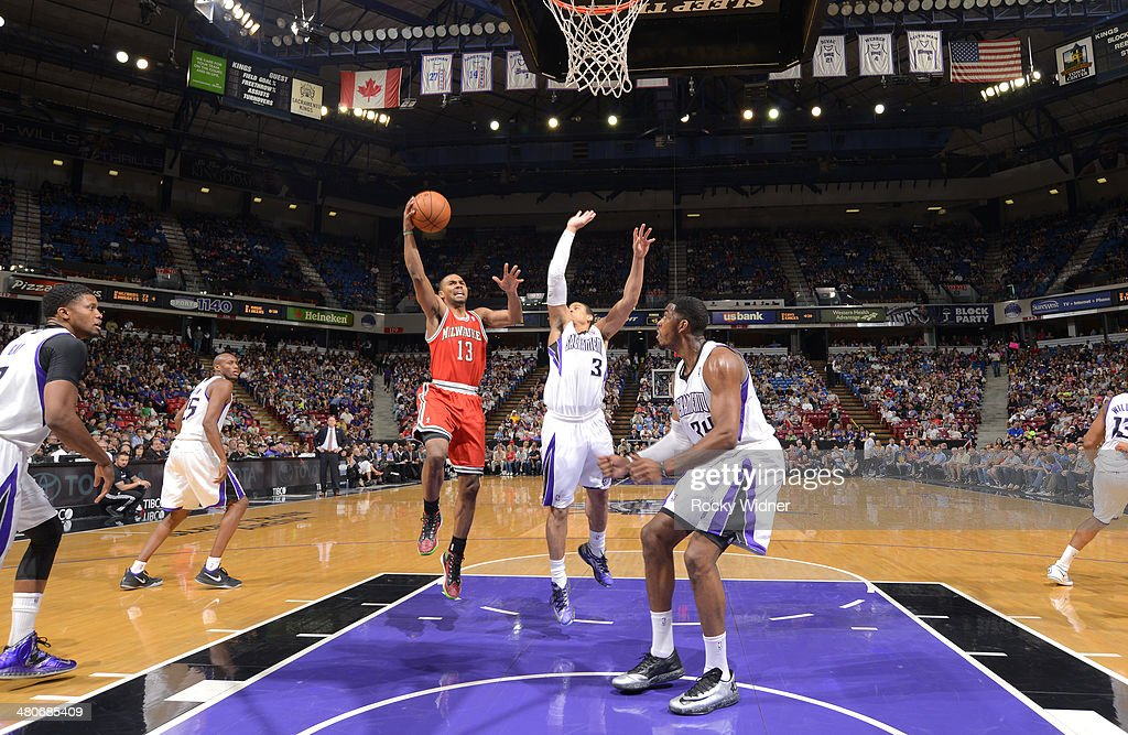 <a gi-track='captionPersonalityLinkClicked' href=/galleries/search?phrase=Ramon+Sessions&family=editorial&specificpeople=805440 ng-click='$event.stopPropagation()'>Ramon Sessions</a> #13 of the Milwaukee Bucks shoots a layup against Ray McCallum #3 of the Sacramento Kings on March 23, 2014 at Sleep Train Arena in Sacramento, California.