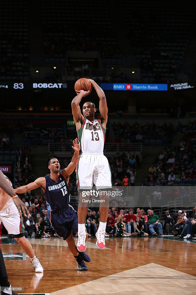 <a gi-track='captionPersonalityLinkClicked' href=/galleries/search?phrase=Ramon+Sessions&family=editorial&specificpeople=805440 ng-click='$event.stopPropagation()'>Ramon Sessions</a> #13 of the Milwaukee Bucks shoots against Gary Neal #12 of the Charlotte Bobcats on March 16, 2014 at the BMO Harris Bradley Center in Milwaukee, Wisconsin.