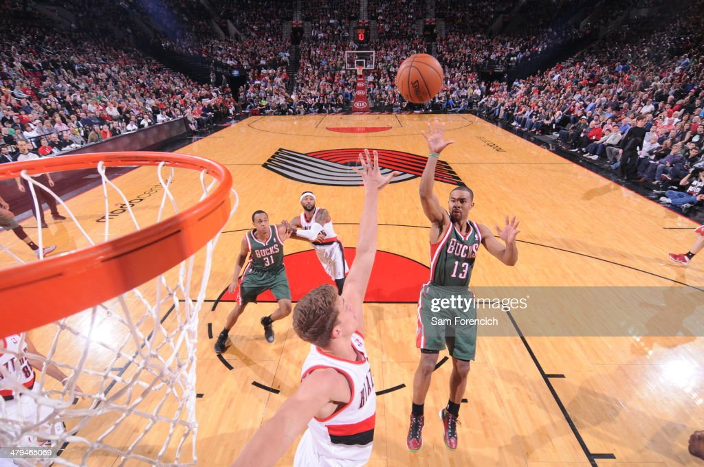 Ramon Sessions #13 of the Milwaukee Bucks shoots against the Portland Trail Blazers on March 18, 2014 at the Moda Center Arena in Portland, Oregon.