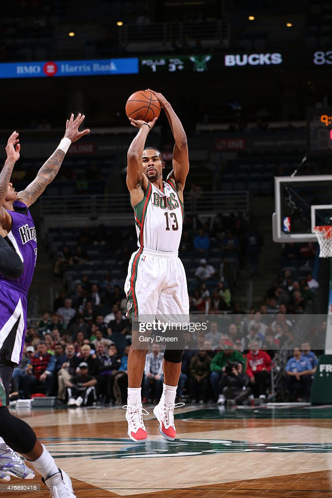 Ramon Sessions #13 of the Milwaukee Bucks shoots against the Sacramento Kings on March 5, 2014 at the BMO Harris Bradley Center in Milwaukee, Wisconsin.