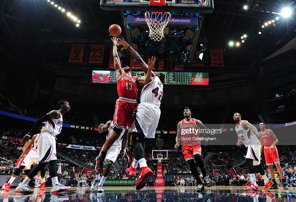 <a gi-track='captionPersonalityLinkClicked' href=/galleries/search?phrase=Ramon+Sessions&family=editorial&specificpeople=805440 ng-click='$event.stopPropagation()'>Ramon Sessions</a> #13 of the Milwaukee Bucks takes a shot against the Atlanta Hawks on March 13, 2014 at Philips Arena in Atlanta, Georgia.