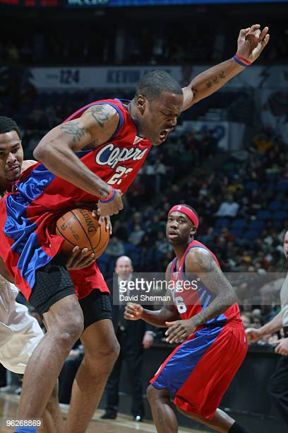 Ramon Sessions of the Minnesota Timberwolves goes for the ball between the legs of Marcus Camby of the Los Angeles Clippers during the game on...