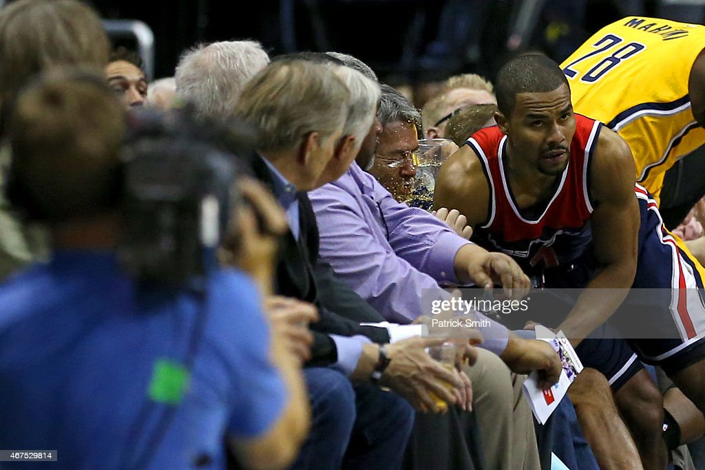 <a gi-track='captionPersonalityLinkClicked' href=/galleries/search?phrase=Ramon+Sessions&family=editorial&specificpeople=805440 ng-click='$event.stopPropagation()'>Ramon Sessions</a> #7 of the Washington Wizards and <a gi-track='captionPersonalityLinkClicked' href=/galleries/search?phrase=Ian+Mahinmi&family=editorial&specificpeople=740196 ng-click='$event.stopPropagation()'>Ian Mahinmi</a> #28 of the Indiana Pacers crash into the crowd in the first half at Verizon Center on March 25, 2015 in Washington, DC.