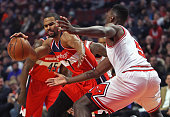 Ramon Sessions of the Washington Wizards drives against Bobby Portis of the Chicago Bulls at the United Center on January 11 2016 in Chicago Illinois...