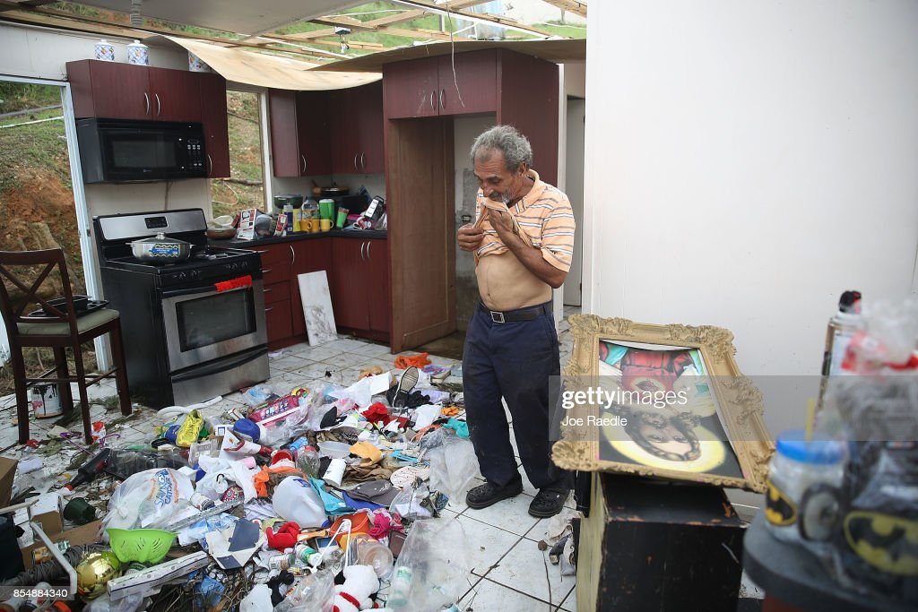 Ramon Torres stands in what is left of his sister-in-law's home as they salvage what they can from the home that was destroyed when Hurricane Maria passed through on September 27, 2017 in Corozal, Puerto Rico. Puerto Rico experienced widespread damage including most of the electrical, gas and water grid as well as agriculture after Hurricane Maria, a category 4 hurricane, passed through.