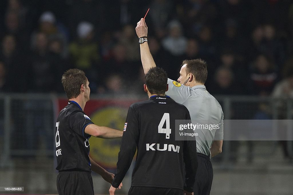 Ramon Zomer of Heerenveen, Christian Kum of Heerenveen, referee Ed Janssen during the Dutch Eredivisie match between RKC Waalwijk and SC Heerenveen at the Mandemakers Stadium on february 1, 2013 in Waalwijk, The Netherlands