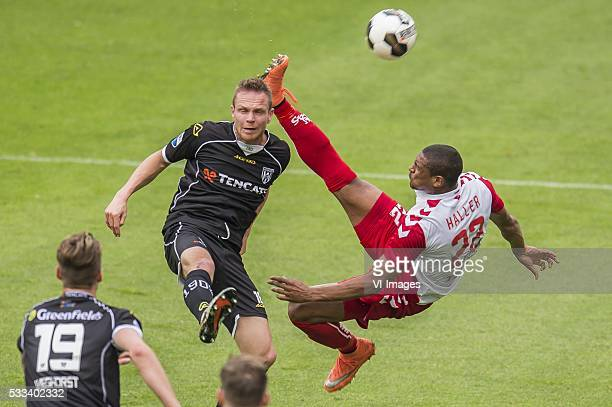 Ramon Zomer of Heracles Almelo Sebastien Haller of FC Utrecht during the Europa League Playoffs return match between FC Utrecht and Heracles Almelo...