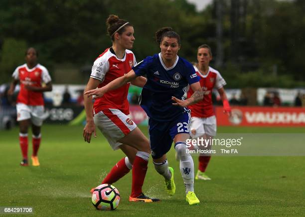 Ramona Bachmann of Chelsea skips past the tackle of Dominique Janssen of Arsenal during the WSL 1 match between Chelsea Ladies and Arsenal Ladies on...