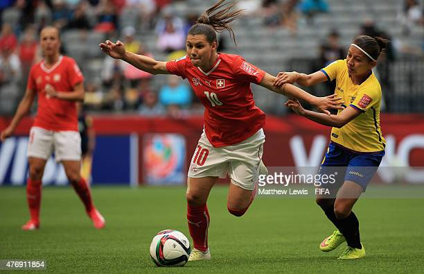 Ramona Bachmann of Switzerland and Angie Ponce of Ecuador challenge for the ball during the FIFA Women's World Cup 2015 Group C match between...